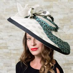 "Queen's Plate Prize Winner Hat Iridescent Peafowl Beauty New, Hand Made and High Quality. 21"" Large brim sinamay hat with inlayed polka dotted fabric between layered sinamay fabric . Hand stiched eyespots applicay showcasing peacock fan, grosgrain ribbon trim and feather details. Materials: Sinamay Structure and headband.   This Fashionable Hat is Perfect for Weddings, Church, The Kentucky Derby, Horse Racing Events, Garden Tea Parties and Charity Events."