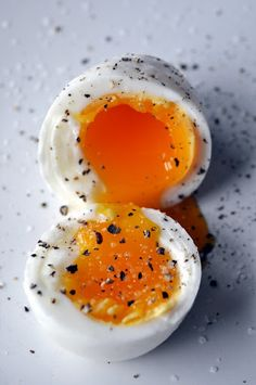 Soft Boiled Egg: bring a few cups of salted water per egg to a raging boil. gently drop eggs in, no more than 6 eggs at a time. set timer for 6 minutes. use a slotted spoon to take eggs out and plunge them quickly into the ice water.