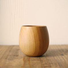 Simple and beautiful round egg shaped tea cup made with Sakura cherry wood that fits nicely in your hands.