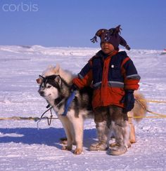 Inuit boy with husky sled dogs, Cambridge Bay, NU