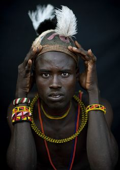 Son of a Turkana chieftain wearing a feather on the head - Kenya | Image and caption by Eric Lafforgue