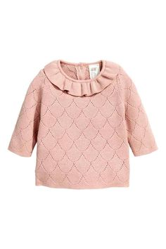 Fine-knit jumper: BABY EXCLUSIVE/CONSCIOUS. Soft, organic cotton jumper in a fine pointelle knit with a frill trim around the neckline and buttons at the back of the neck.