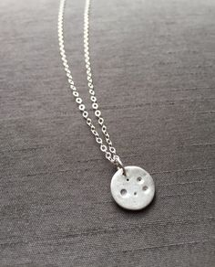 "Minimalist Style; Tiny Crater Moon Pendant handcrafted in fine silver(.999%) and hangs on your choice of 15-17"" delicate sterling silver chain. ($28) #moonjewelry #silverjewelry #modernjewelry"
