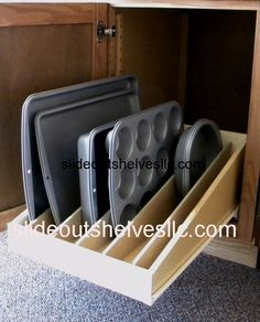 Pull out shelf organizer for baking sheets, muffin, cupcake and cake pans