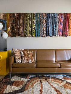 A collection of vintage ties hang in Troy Litten's home