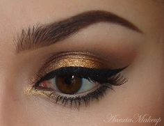 Golden shadow with a cat eye. #prom2013 #gold #makeup