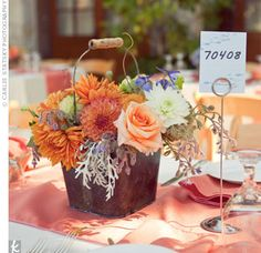Orange and White Centerpieces...like the rustic feel with the bucket