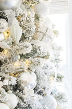 White and silver balsam hill christmas tree ornaments on flocked tree ♛BOUTIQUE CHIC♛ Flocked Christmas Trees Decorated, Balsam Hill Christmas Tree, White Christmas Tree Decorations, White Christmas Trees, Elegant Christmas, Christmas Home, Christmas Tree Ornaments, Holiday Decor, Southern Christmas