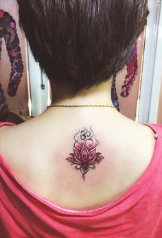 I considered a lot before I got this tattoo. It spiritually means so much to me. It's lotus with an om symbol above.