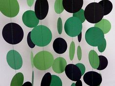 Green Party Decorations, Paper Garland, Green and Black, 10 ft. on Etsy, $10.00  ---- make these in each kid's colors for their ends of the table for the dual party