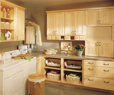 What makes dreams come true in a laundry room? Well, let's start with fashionable Natural Maple Cabinets, configurable to fit any space. Then add in both open and closed storage galore, with a place for everything from detergents, to hanging items, to clean clothes. Finally, plenty of countertop space for sorting and folding. Don't wait - start planning now to make this task more of a pleasure than a chore.