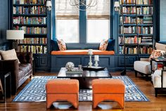 Very deep shades of blue provide a stately dignity to any room in your home, as seen in this cozy library.   - CountryLiving.com