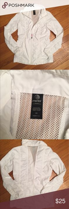 White windbreaker xs Very lightweight windbreaker with mesh strip along back. Awesome details throughout including reflective spots on sleeves, ruching. Very tiny stain on back (as pictured) will probably come out easily i just never tried  worn once, like new. Size xs. mpg Jackets & Coats