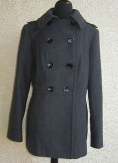 this wool blend coat from Michael Kors will keep you cozy and in style. The coat is fashioned with a classic double-breasted front.   •Color options: Gray, charcoal •Notched lapel •Two front welt pockets  •Fully lined  •Wide cuffs  Ebay item #161040814644 Sale price $59.99