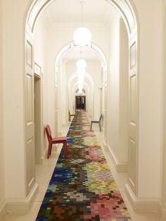 Amazing white corridor with bright rug