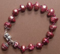 Items similar to Hand knotted garnet gemstone beads, mauve color fresh water pearls and Bali sterling silver beaded magnetic bracelet on Etsy Garnet Gemstone, Gemstone Beads, Mauve Color, Fresh Water, Gemstones, Pearls, Sterling Silver, Unique Jewelry, Bracelets