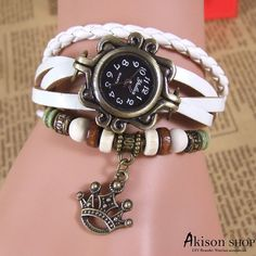 $2.89/pcs Handmade Vintage Leather Band Watches Lady Woman Wrist Watch with crown, Leather Watch Bracelets Buy Link: https://www.akisonshop.com/watch/vintage-leather-bracelet-quartz-wrist-watch-crown-S002.html