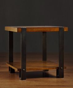 Invigorate the interior with the addition of this attractive end table. Its classy, contemporary look and chic silhouette bring fashion-forward design to any den or living room.