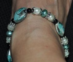 Aqua swirl glass beads, pearls and black onyx with silver accents on this ankle bracelet - $16.50.