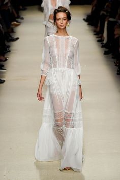 We love this beautiful white semi- sheer Alberta Ferretti couture gown seen at Milan Fashion Week  - TownandCountryMag...x