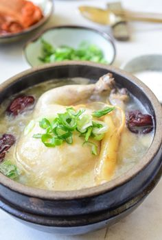 Ginseng chicken soup, samgyetang, is an iconic summer dish in Korea. The ginseng flavored meat is tasty and tender, and the broth is rich and delicious! Whole Chicken Soup, Korean Chicken Soup, Asian Soup, Chicken Soup Recipes, Chicken Soups, Recipe Chicken, Chicken Rice, Korean Dishes, Korean Food