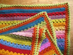pillow edging crochet Crocheting blanket edgings is one of my most favourite things, I love the challenge of choosing exactly the right colours and designing exactly the right sor Crochet Blanket Border, Granny Square Crochet Pattern, Crochet Borders, Crochet Pillow, Crochet Blanket Patterns, Crochet Stitches, Knitting Patterns, Crochet Blankets, Crochet Afghans