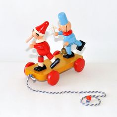 Vintage Mid Century Sevi Italy Wooden Pull along Toy Policeman Brio Toys, Pull Along Toys, Pull Toy, Stainless Steel Flatware, Wooden Pegs, Japanese Pottery, Brass Handles, Vintage Christmas Ornaments, Product Label