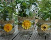 Mason jars in burlap and green checkered ribbon with yellow flowers