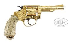 Smith & Wesson Engraved Model S&W Long, gold plated finish barrel and about coverage engraving. Very unique Tiffany style grips. Cool Gear, Smith Wesson, Airsoft Guns, Michael J, Revolver, Firearms, Hand Guns, Weapons, Plating