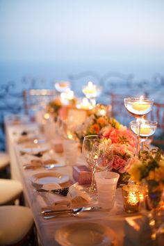 #candles #tablescape Photography by caughtthelight.com/ Event Planning by lavenderandroseweddings.fr/ Floral Design by waynerileyflowers.fr/ Read more - http://www.stylemepretty.com/2013/06/03/french-riviera-wedding-from-caught-the-light/