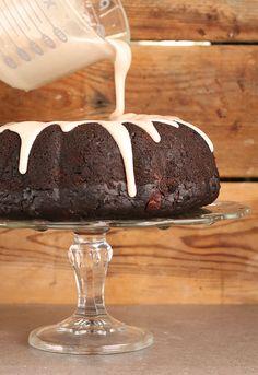 A rich and moist vegan Chocolate Hazelnut Zucchini Cake with cinnamon glaze; the perfect dessert to celebrate the beginning of fall.