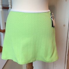 """Ralph Lauren Lycra Sport Skirt NWT, lime skirt with white trim. Body is 90% nylon and 10% Lycra/spandex. White trim is 90% polyester, 10% lycra/spandex. Very cute, comfortable, stretchy skirt. Waist measures about 13"""" side to side and top to bottom measures 12.5"""" Ralph Lauren Skirts"""