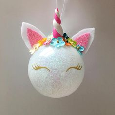 ***Please leave a note upon check out with the name youd like on the back***  Make your Christmas tree whimsical and magical with this handmade glass ornament! Give this to your favorite little girl and watch her eyes light up when she sees her name on the back!  Each ornament is made to order and there can be some variations in the color of flowers. Completely handmade, right down to the clay horn.