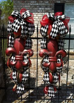 Door swags with burlap, red, black and harlequin ribbons and large fleur de lis