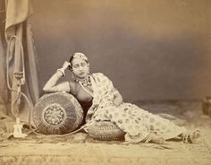 A Reclining Woman Wearing Jewellery, with a Hookah on the Left - Lucknow 1872