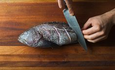Scoring the fish on both sides is a must for even cooking.