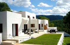 For a gossip - Can Alexia.  For the full-on Ibizan experience, you must rent a villa – like this seven-bedroom delight which sits prettily on top of a hill like a collection of elegant sugar cubes.