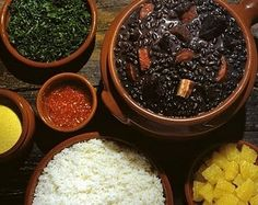 Feijoada brasileira! Black Bean Stew is often served on Saturdays. Fatty and rich with pork parts and sausage, it is accompanied by rice, toasted coarse manioc flour, and tangy oranges. The drinks of choice are usually Guarana - a favorite Brazilian soft drink - or Coke.