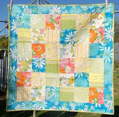 Children's picnic quilt.  Made from re-purposed fabrics.  Sold in 2011