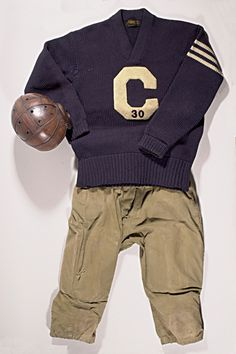"""Vintage football uniform c.1920-30's. Includes leather helmet with donut style ear flaps, """"C"""" letterman's sweater with """"Howard Beardslee"""" chain stitched inside tail, and pair of reeded canvas pants with Leacock Sptg. Goods tag inside waist. $275"""