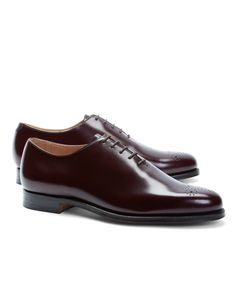 Medallion toe dress shoes, made from fine calfskin leather. Leather sole. Goodyear welted. Leather lined. Tone-on-tone stitching. Made in England.