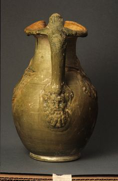 Roman  Lead-glazed oinochoe with relief decoration, 1st century B.C. – 1st century A.D.  Terracotta