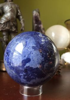 A personal favorite from my Etsy shop https://www.etsy.com/listing/273091458/gorgeous-blue-sodalite-sphere-crystal