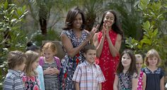 Malia and her mother, first lady Michelle Obama, celebrate with children of U.S. embassy workers after dedicating two magnolia trees and a bench at a small park in Old Havana, Cuba, on March 22, 2016.   (AP)