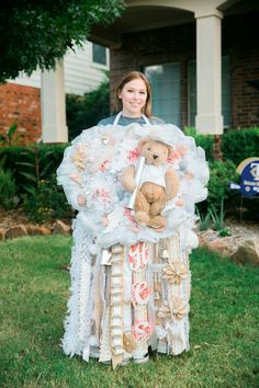 HUGE football Homecoming mum. Bigger in Texas!   Burlap and coral. Made.by ACTS CreaTive