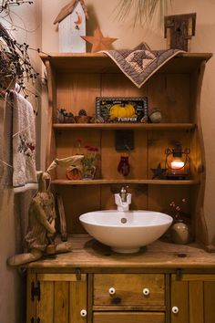 Love this set up ...would have to have a mirror in it...great idea for powder room Log Home Photos | Bedrooms & Bathrooms › Expedition Log Homes, LLC