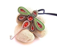 Items similar to Zipper Dragonfly Pendant in Green and Pink on Etsy Dragonfly Jewelry, Dragonfly Pendant, Zipper Jewelry, Beaded Jewelry, Collar Hippie, Jewelry Crafts, Handmade Jewelry, Zipper Flowers, Fabric Flowers