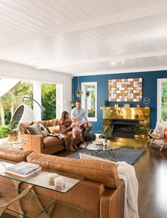 Kelly, Nathan and Havana Coe of in their striking living room, with feature wall in 'Blue Night'. Blue Feature Wall Living Room, Living Room Colors, Feature Walls, Living Rooms, Wall Colors, House Colors, Colours, Velvet Wingback Chair, Interior Styling
