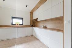 Projekt domu w okolicach Poznania ok. 120 m2 - Średnia zamknięta kuchnia w kształcie litery l z oknem, styl nowoczesny - zdjęcie od Architektownia