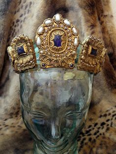Incredible amethyst and pearl, coronet, crown. Would be perfect for reenactment, theater or even a royal themed wedding. This is truly a one of a kind design. All the stones are real, no glass or plastic here. A lavender and white color theme is created with large cultured pearls, and lavender hued amethyst stones. Crafted from polymer clay this unbelievably decadent coronet bends sumptuary laws to its will. Easily transportable as it curls on itself or can be laid flat. For all the SCA…